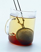 Cup of tea with tea ball