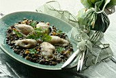 Hot oysters with creamy lentils