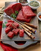 Chunks of raw beef for fondue on platter