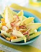Chicory salad with grated ham and cheese