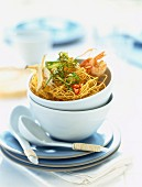 Fried noodles with shrimps, fish and leeks