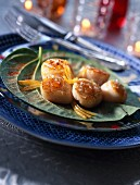 Pan-fried scallops with harissa oil and confit lemon
