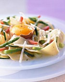 Pasta with vegetables and raw egg