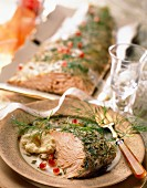 Salmon with herbs, cream of garlic and pomegranate