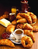 Croissants and pastries with cup of white coffee