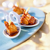Langoustine bites with honey and ginger