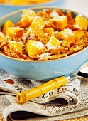 Bowl of cereal with mango and coconut