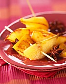 Pineapple and pear skewers with star anise