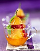 Stewed pear in syrup with summer fruit