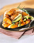 Roast young cockerel with kiwis and dried fruit