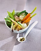 Crunchy vegetables with sesame seeds and green tea