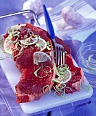 Raw sirloin steaks