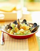 Mussel, potato and onion casserole