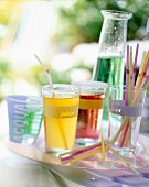glasses of cordial and straws