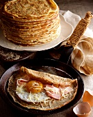 Egg and ham crepe in pan