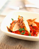 Thinly sliced chicken with peppers, tomatoes and anchovies