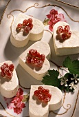 Heart-shaped blancmange with redcurrants