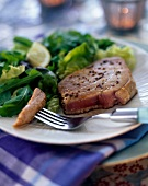 half-cooked tuna with herb leaf salad