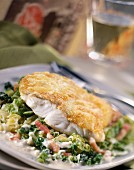 Baked pike-perch steak with grated cabbage