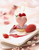 Heart-shaped, pink macaroon with summer fruit for St Valentine's Day