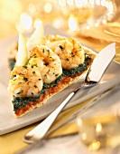 Slice of prawn, spinach and tomato tart