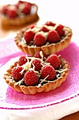 Inidividual plain chocolate and raspberry tarts