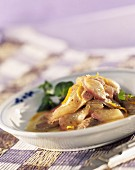 Sliced duckling breast with preserved pears