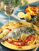 Grilled bream with tomato sauce and peppers