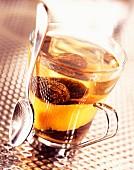 Prunes in tea with orange zest (topic : drinking fruits)