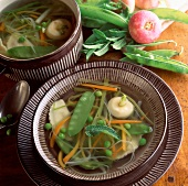Spring soup with peas, sugar peas and leeks