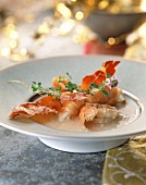 Creamed coconut soup with roast langoustines and serrano ham