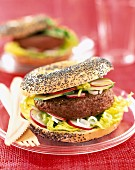 hamburger in poppy seed bagel