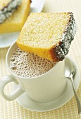 Slice of yoghurt cake with mug of hot chocolate