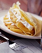 Pancake filled with camembert and baked apples