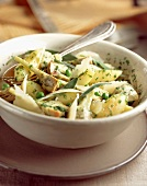 Potatoes with artichokes, peas and Parmesan