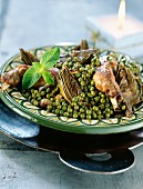 Pea, rabbit and artichoke tajine