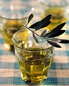 Glasses of olive oil with leaves