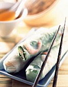 Spring rolls with chopsticks