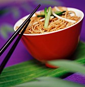 Bowl of Chinese noodles with chopsticks