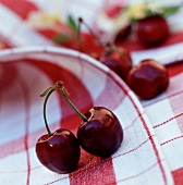 Fresh cherries on checked napkin