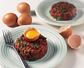 Steak tatar with capers and a raw egg