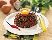 Steak tartare with hot peppers and capers