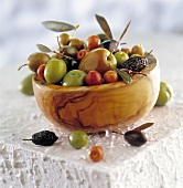Mixed olives in olive wood bowl