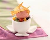 fruit salad, strawberry ice cream and pine nut triangle