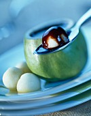 Granny Smith apple with melted chocolate