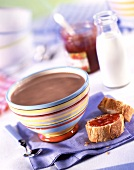 Breakfast with hot chocolate, bread and jam