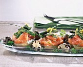 Artichoke bases garnished with smoked salmon