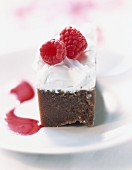 Fromage blanc mousse on chocolate sponge cake with raspberries