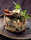 Fish and potato tartare with ceps and quail eggs
