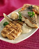 grilled sea bass with white sauce